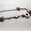 Bijou de tête Headband cuivré, fleurs ajourées et perles chocolat